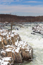 Potomac river in winter at great falls national park virginia vertical landscape of the raging as it cascades over snow capped Royalty Free Stock Images