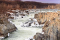 Potomac river in winter great falls park virginia the wild as it cascades over the icy snow capped rocks at national Royalty Free Stock Images