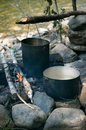 Pots on the campfire in the campaign on the river Royalty Free Stock Photography