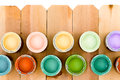 Pots of colorful wood stain on a fence Royalty Free Stock Photo