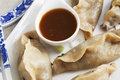 Potstickers appetizer orange soy sauce Royalty Free Stock Images