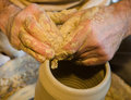 The potter hands forming a jar Royalty Free Stock Photos