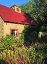 Potting shed in a garden this has flowers and vegetables growing all around Royalty Free Stock Photos