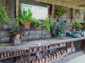 Potting shed and pots with terra cotta plants Stock Image