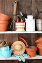 Potting shed shelves closeup of items on the of a the rustic interior is full of flower pots and other accessories and tools used Royalty Free Stock Image