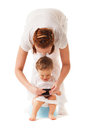 Potty training mother performs with her son using smartphone Stock Images