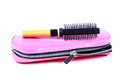 Pouch and hair roller brush Royalty Free Stock Photo