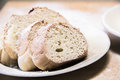 Poudered slices of bread in a white plate on the table Royalty Free Stock Photo