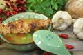 Poultry consomme with chicken skewers and smooth parsley Royalty Free Stock Photo