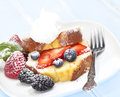 Pound cake with fruit and a whipped topping Royalty Free Stock Images