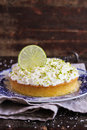 Pound cake with lemon, lime and freshly shredded coconut with cream cheese frosting Royalty Free Stock Photo