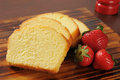 Pound cake and strawberries slices of rich moist with fresh Royalty Free Stock Photo