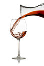 Pour red wine from a decanter Royalty Free Stock Photo