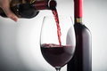 Pour red wine into glass Royalty Free Stock Photo