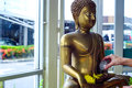 pour water over a Buddha statue Royalty Free Stock Photo