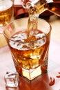 Pour the whiskey into glass beaker Stock Photos
