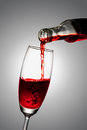 Pour the wine into a glass red Stock Images