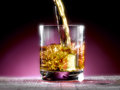 Poured whiskey into the glass Royalty Free Stock Photography