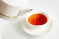 Pouring boiling water into a tea cup Royalty Free Stock Photo