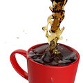 Pouring coffee splashing into red mug d on white background Royalty Free Stock Photography