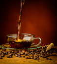 Pouring coffee still life with fresh hot black and beans Royalty Free Stock Images