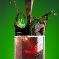 Pouring a cola in glass Stock Images