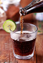 Pouring cola to a glass Royalty Free Stock Photo