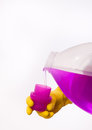 Pouring detergent into cap of bottle Royalty Free Stock Photo