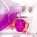 Pouring detergent for washing machine Royalty Free Stock Photo