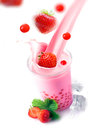 Pouring a glass of strawberry boba tea Royalty Free Stock Photo