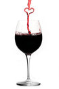 Pouring a heart of red wine Royalty Free Stock Photo