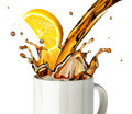 Pouring lemon tea splashing into a glass mug at white background Stock Photos