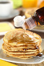 Pouring Maple Syrup on Pancakes Royalty Free Stock Photos