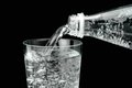 Pouring mineral water in the glass Royalty Free Stock Photo