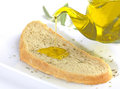 Pouring olive oil virgin on a slice of bread with oregano Royalty Free Stock Image