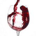 Pouring red wine into wine glass Stock Photography