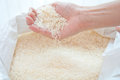 Pouring rice from hand Stock Images