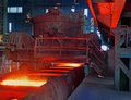 Pouring steel into ingot moulds. Royalty Free Stock Photo