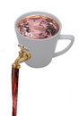 Pouring tap on coffee cup Royalty Free Stock Image