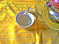 Pouring tea into a cup Royalty Free Stock Photo