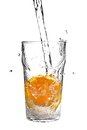 Pouring water into glass with orange slice Royalty Free Stock Photo