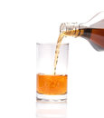 Pouring whisky into glass on white background Royalty Free Stock Photo