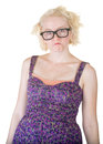 Pouting cute nerd female in purple dress and glasses Stock Image