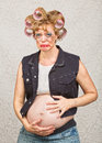 Pouting pregnant hillbilly single female in blue jeans Royalty Free Stock Images