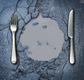 Poverty and hunger concept with a fork knife on a broken asphalt road shaped as a dinner plate as a social problem of food Royalty Free Stock Photography