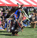 Pow wow man dancer face paint american indian dancing at a with bold Royalty Free Stock Image