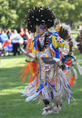 Pow wow man dancer fringe flying american indian dancing at a with large head dress and Stock Photo