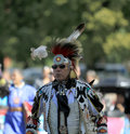 Pow wow man dancer with glasses american indian dancing at a Stock Photos