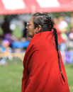 Pow wow woman american indian with long braid in a red blanket at a Royalty Free Stock Photos