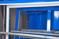 Powder coating and drying of metal blue doors Royalty Free Stock Photo